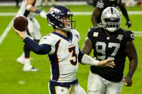 Las Vegas Raiders defensive tackle Maliek Collins (97) puts pressure on Denver Broncos quarterb ...