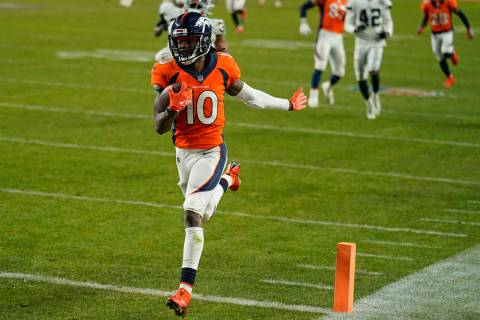 Denver Broncos wide receiver Jerry Jeudy (10) scores a 92-yard touchdown against the Las Vegas ...