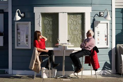 A couple dines outdoors at Scoma's restaurant Friday, Dec. 4, 2020, in Sausalito, Calif. (AP Ph ...