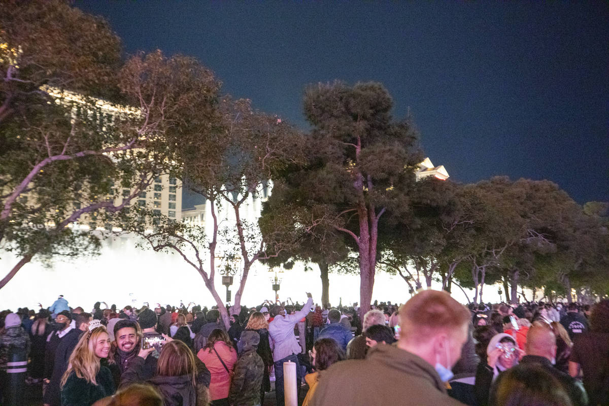 Individuals gather to celebrate New Year's Eve on the Las Vegas Strip, Thursday, Dec. 31, 2020. ...