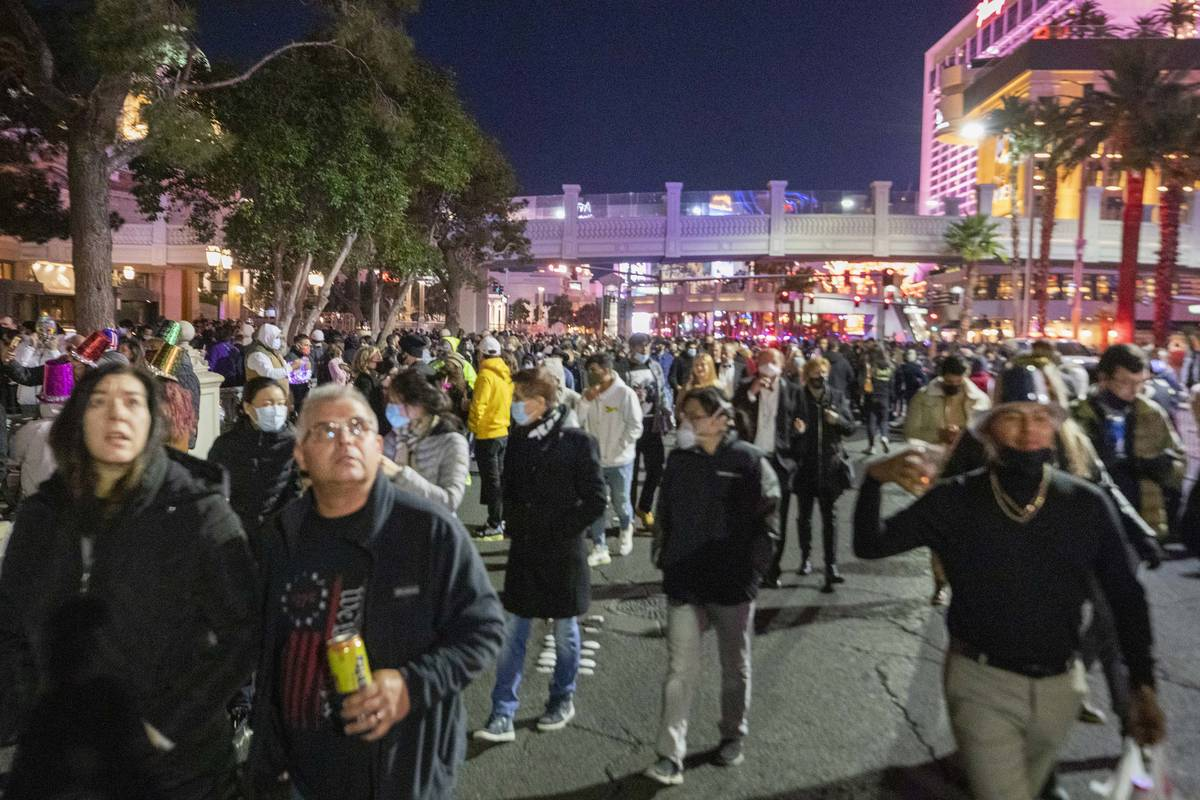 Individuals gather to celebrate New Years Eve on the Las Vegas Strip, Thursday, Dec. 31, 2020. ...