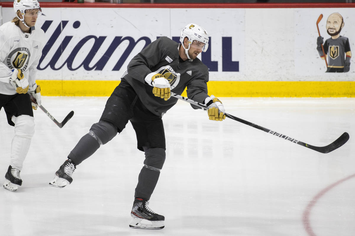 Golden Knights defenseman Shea Theodore (27) shoots on goal during practice at City National Ar ...