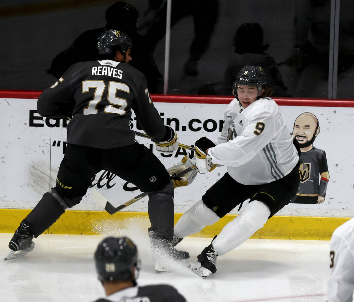 Golden Knights center Cody Glass (9) battles for the puck with right wing Ryan Reaves (75) duri ...