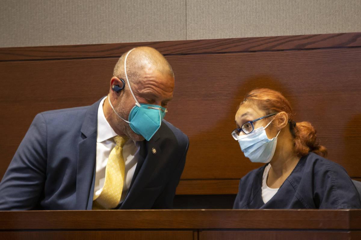 Jasmin Vargas communicates with her attorney, David Fischer, during a court hearing at the Regi ...