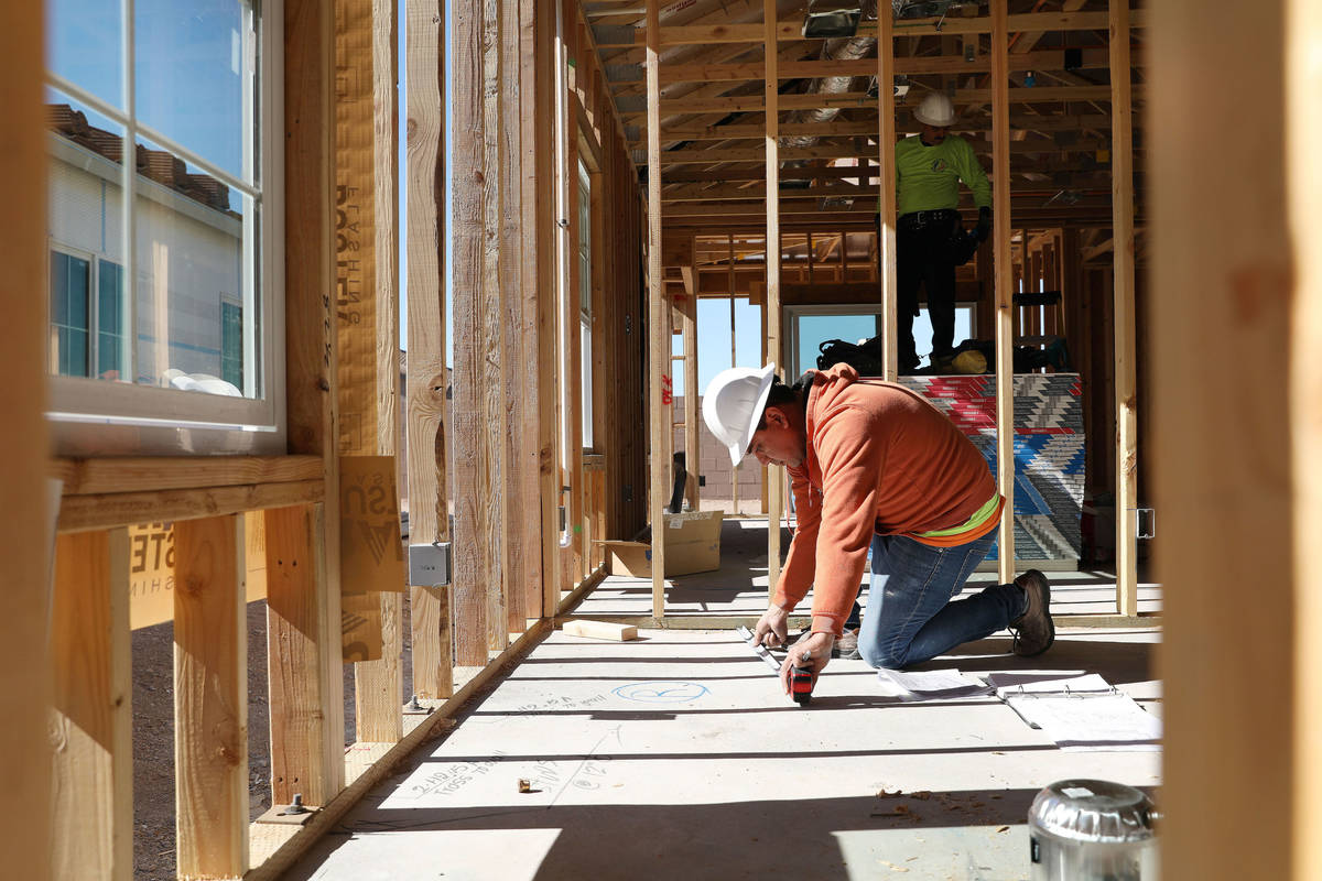 Supervisor Antonio Mondrago works on electricity plans on StoryBook home development in Cadence ...