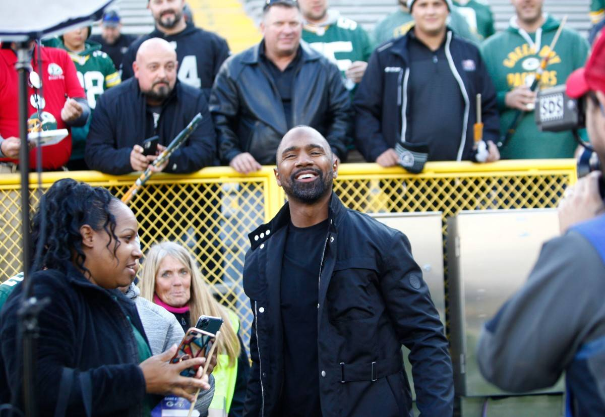 Former Raiders and Green Bay Packers cornerback Charles Woodson meets with fans before an NFL g ...