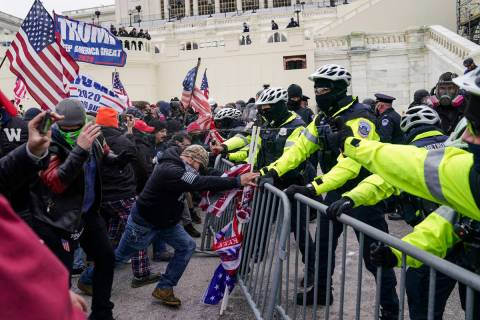 President Donald Trump supporters try to break through a police barrier, Wednesday, Jan. 6, 202 ...