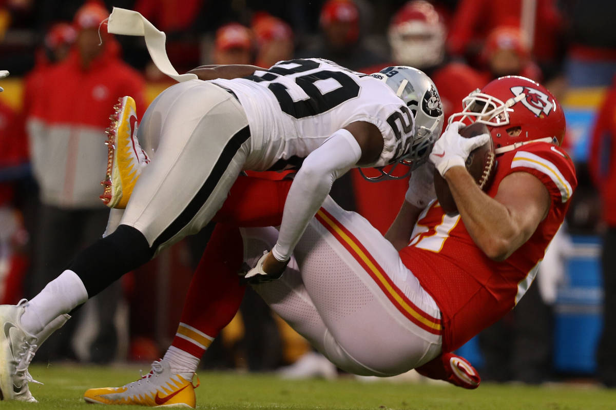 Kansas City Chiefs tight end Travis Kelce (87) is tackled by Oakland Raiders free safety Lamarc ...