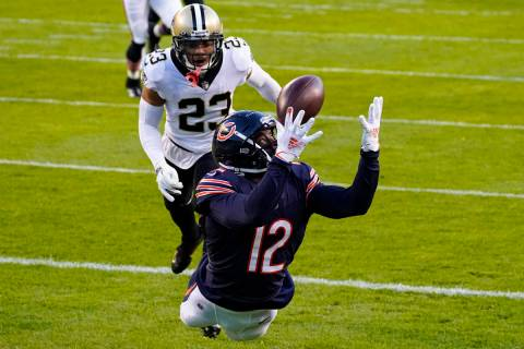 Chicago Bears wide receiver Allen Robinson (12) makes a catch for a touchdown in front of New O ...