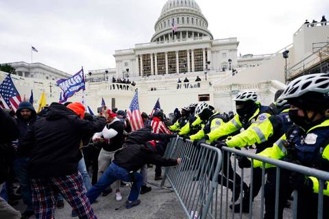 Trump supporters try to break through a police barrier, Wednesday, Jan. 6, 2021, at the Capitol ...