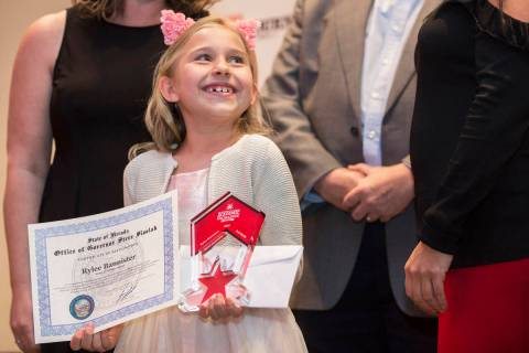 Award winner Rylee Bannister, left, a second grader from Staton Elementary School, smiles at th ...