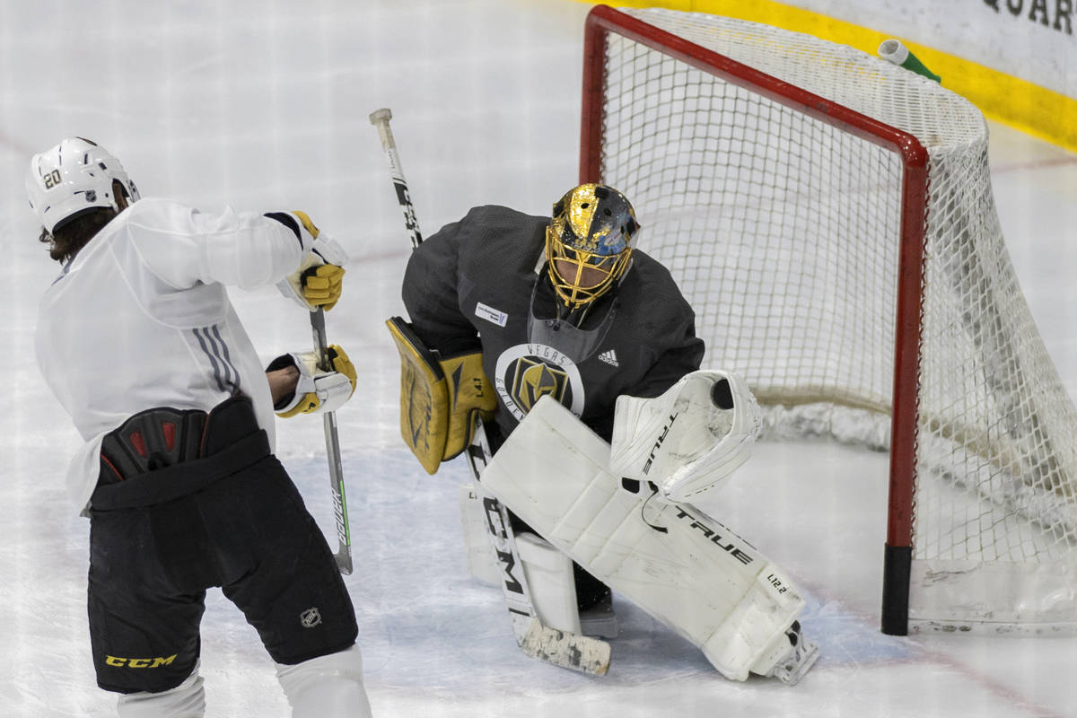 Golden Knights goaltender Marc-Andre Fleury (29) makes a save against Golden Knights forward Ch ...