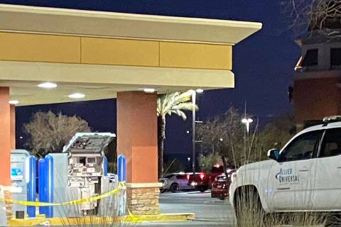 Las Vegas police investigate a theft at a Chase Bank ATM, 8565 W. Warm Springs Road, on Monday ...