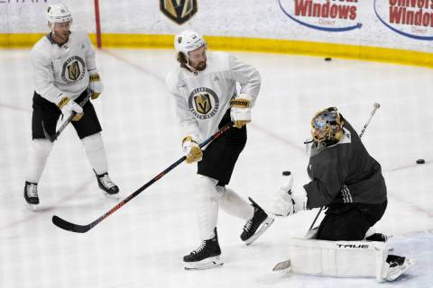 Golden Knights forward Mark Stone (61) redirects a shot at Golden Knights goaltender Marc-Andre ...