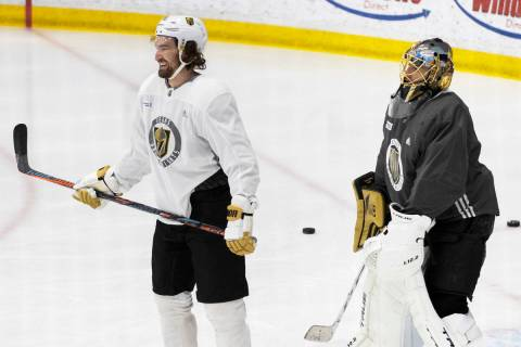Golden Knights forward Mark Stone (61) and Golden Knights goaltender Marc-Andre Fleury (29) wor ...