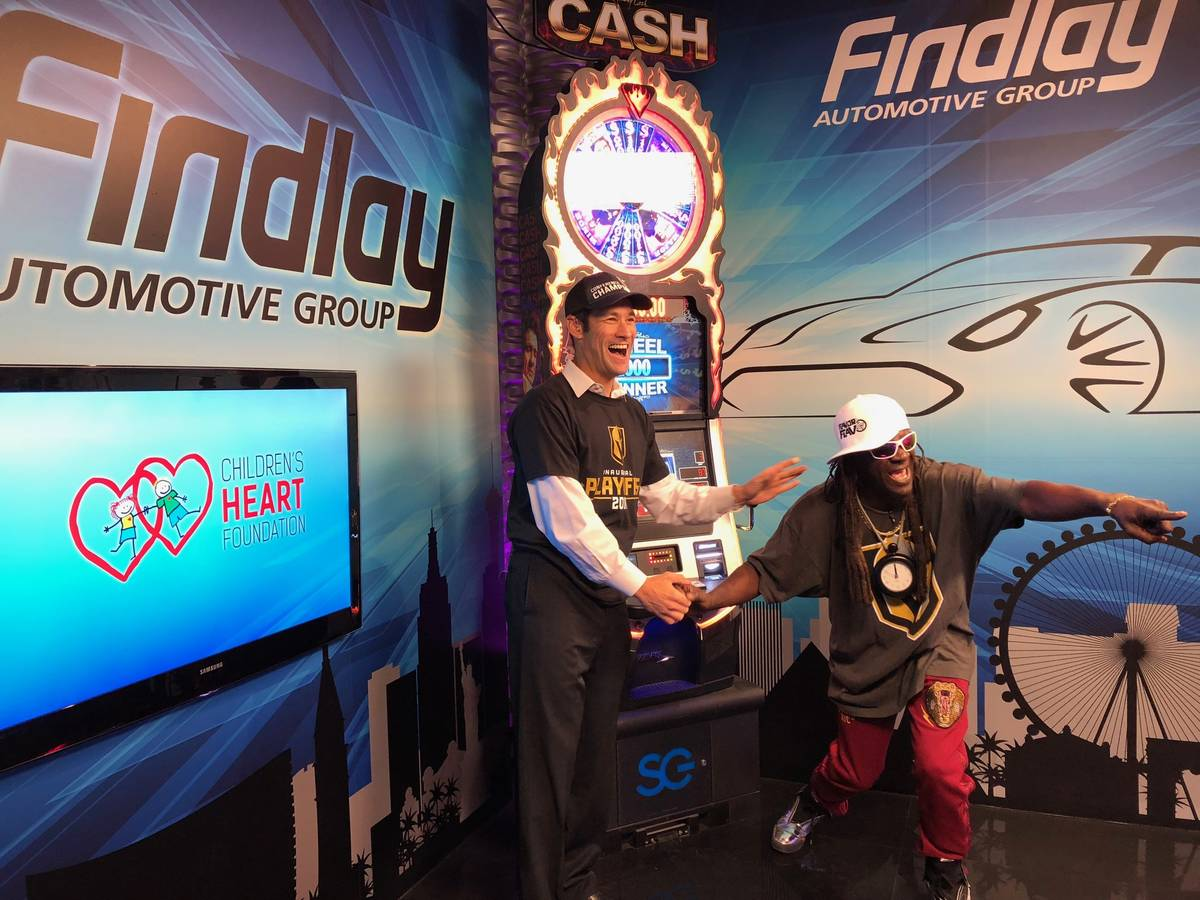 """Jason Feinberg, co-host of Fox 5's """"More"""" show, cheers on Rapper Flavor Flav, who was tak ..."""