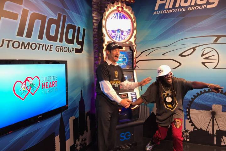 "Jason Feinberg, co-host of Fox 5's ""More"" show, cheers on Rapper Flavor Flav, who was tak ..."