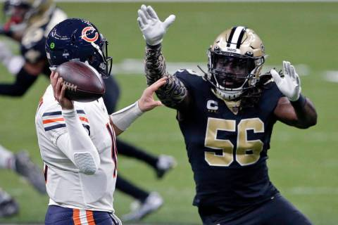 Chicago Bears quarterback Mitchell Trubisky passes under pressure from New Orleans Saints outsi ...