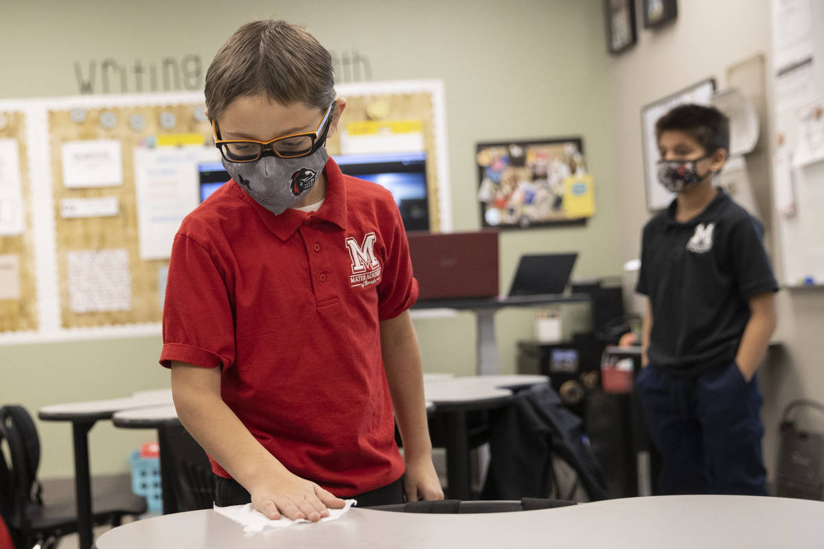 Daniel Saunders wipes down his desk at the end of his class at Mater Academy East Campus in Las ...