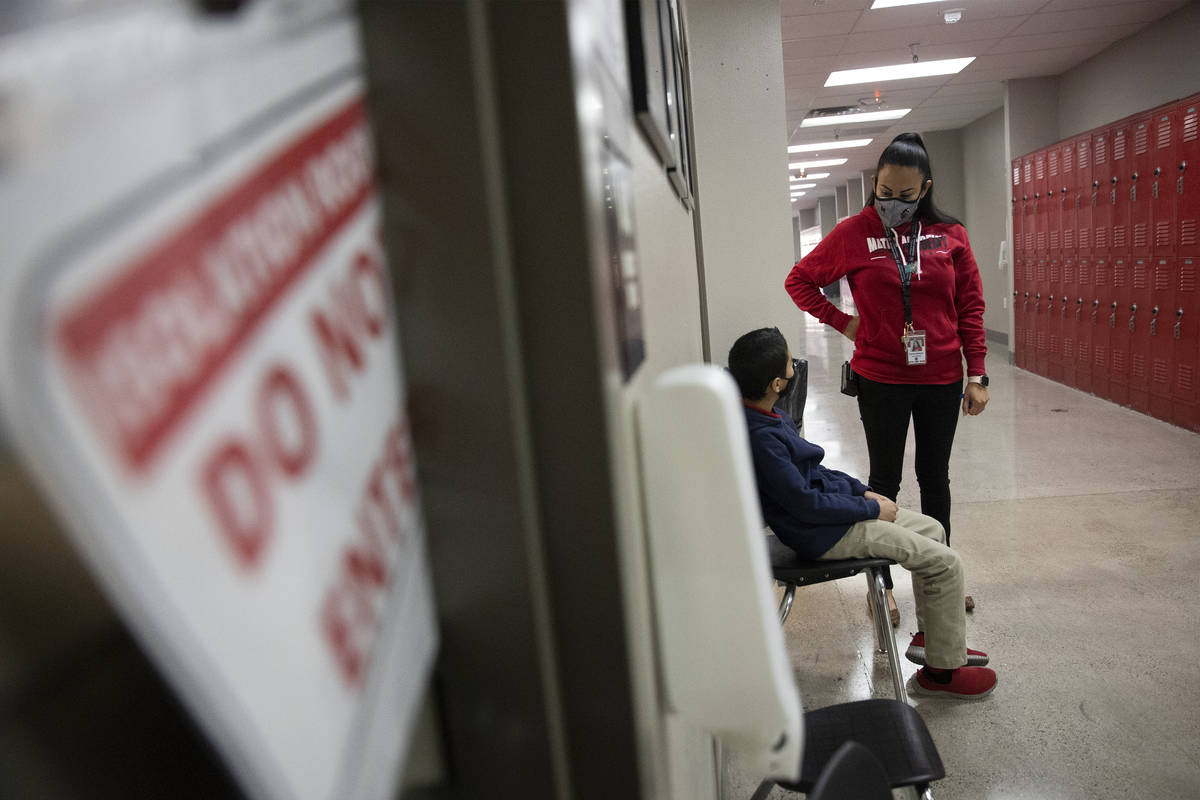 School nurse Kenia Delatorre speaks to a student outside of her office at Mater Academy East Ca ...