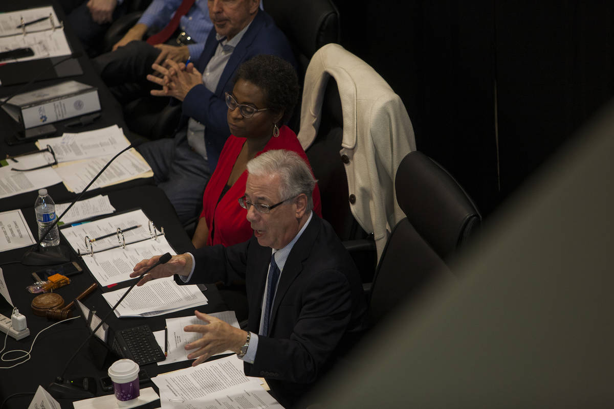 Regent Dean Gould, who is also chief of staff and special counsel to the board, speaks alongsid ...