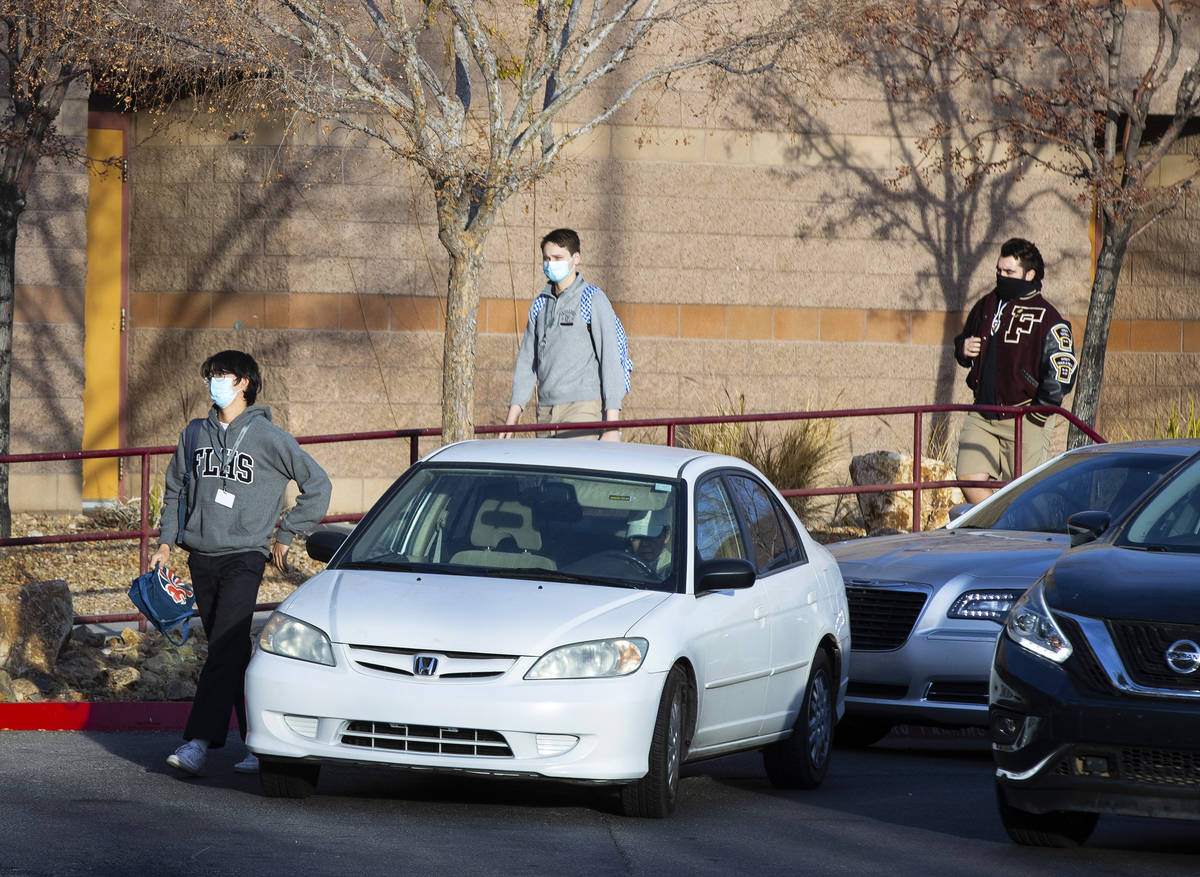 Faith Lutheran Middle School and High School students are seen after being dropped off, on Wedn ...