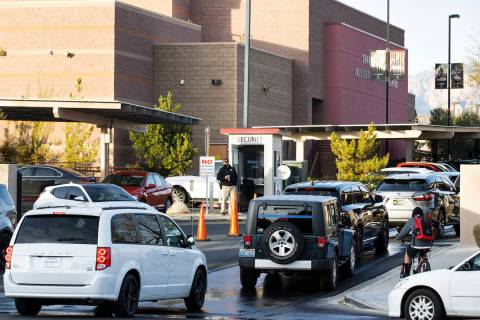 Parents in their cars lined up to enter Faith Lutheran Middle School and High School to drop of ...