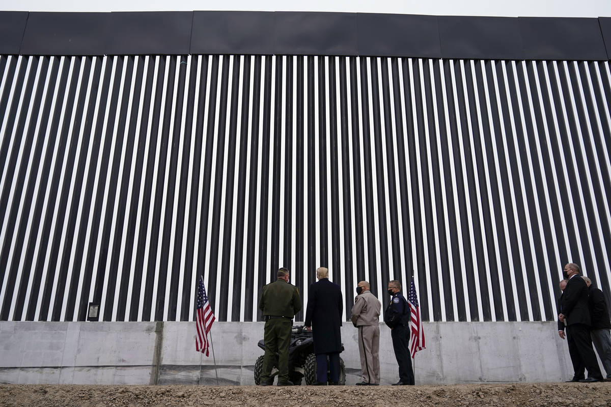 President Donald Trump tours a section of the U.S.-Mexico border wall under construction Tuesda ...