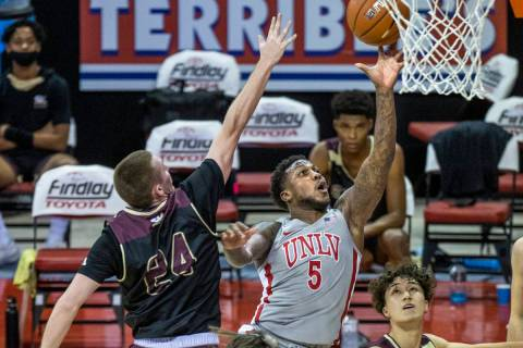 UNLV Rebels guard David Jenkins Jr. (5) gets off a touch shot past Saint Katherine guard/forwar ...