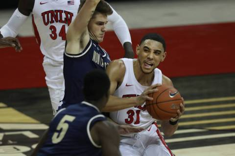 UNLV Rebels guard Marvin Coleman (31) is pressured by Montana State Bobcats guard Nick Gazelas ...
