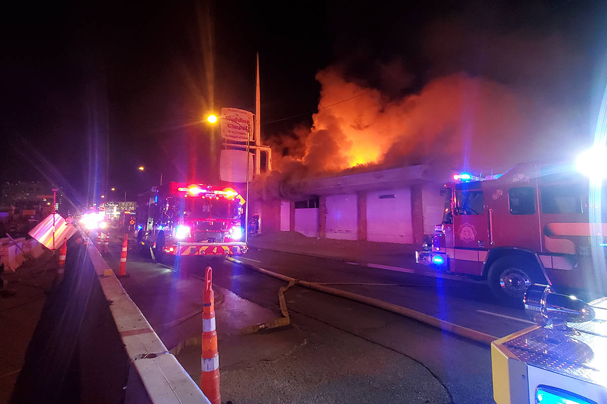 Crews battle a fire Tuesday, Jan. 12, 2021, at a vacant building on 1431 Las Vegas Blvd. South ...