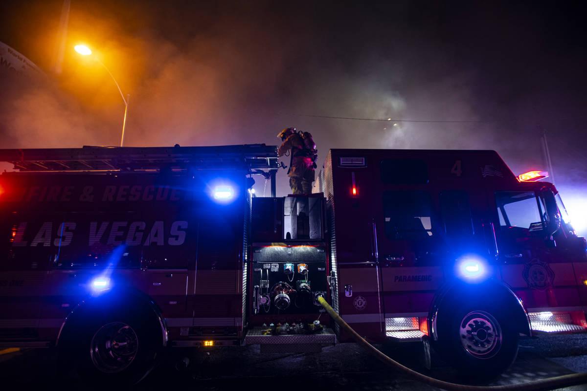 Las Vegas firefighters battle flames engulfing a vacant wedding chapel at 1431 S. Las Vegas Blv ...