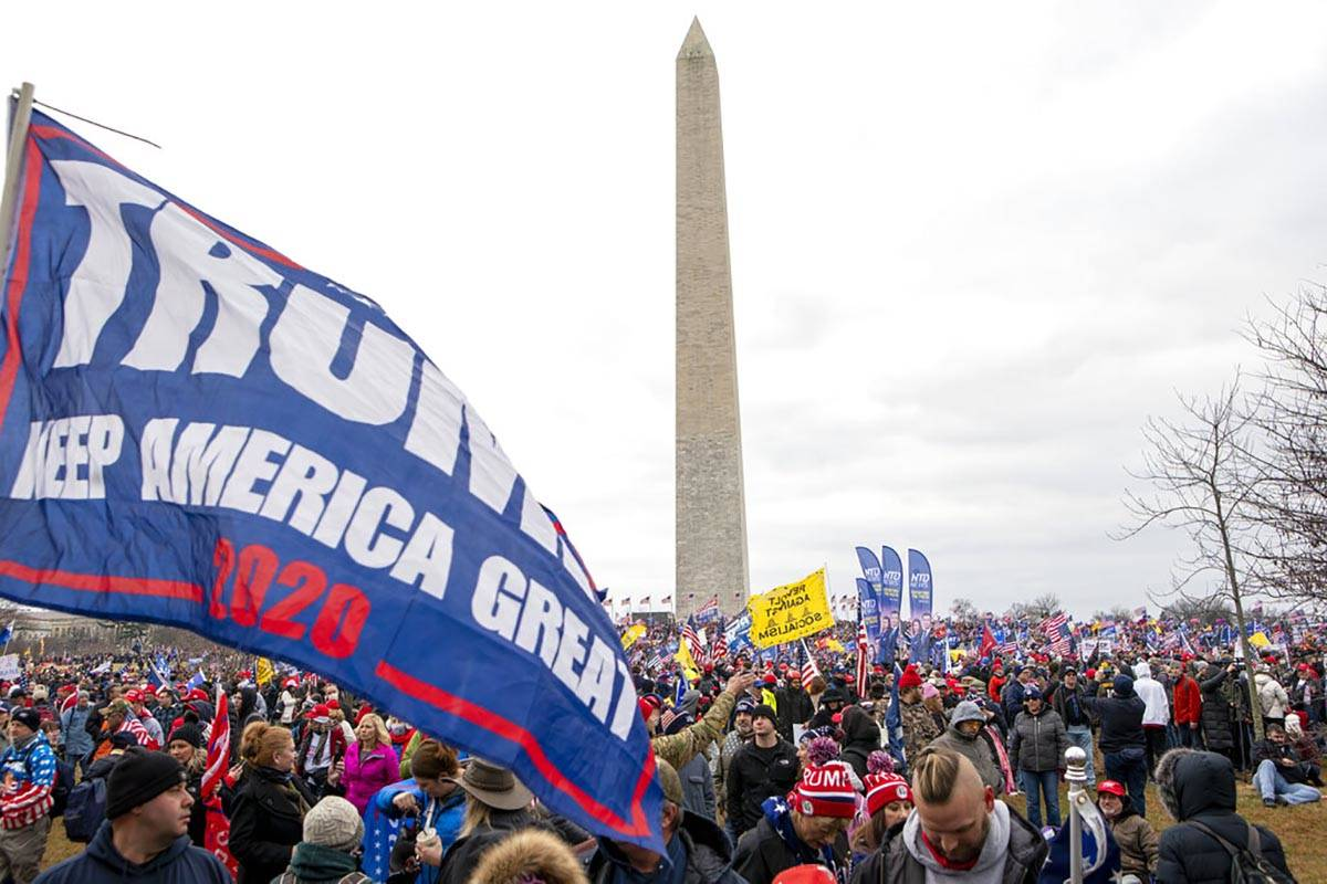 With the Washington Monument in the background, people attend a rally in support of President D ...