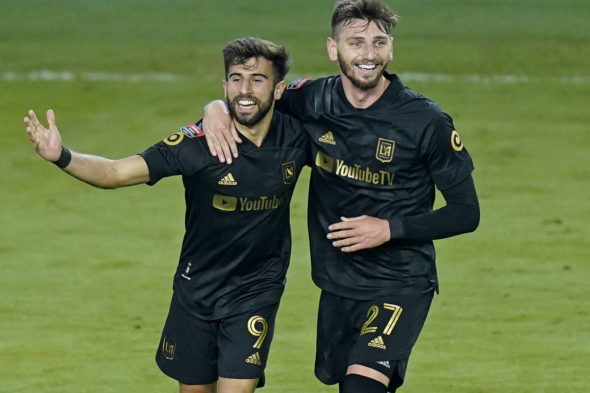 Los Angeles FC forward Diego Rossi (9) celebrates his goal against Tigres with defender Tristan ...