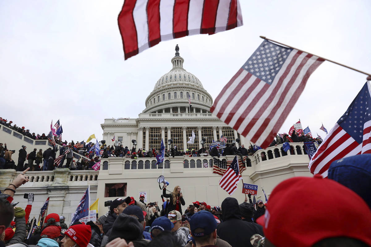 FILE - In this Wednesday, Jan. 6, 2021 file photo, supporters of President Donald Trump gather ...