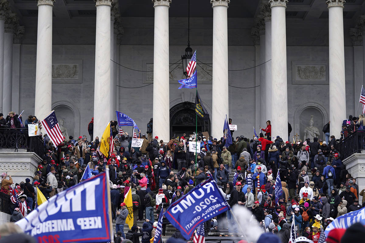 Trump supporters rally Wednesday, Jan. 6, 2021, at the Capitol in Washington. As Congress prepa ...