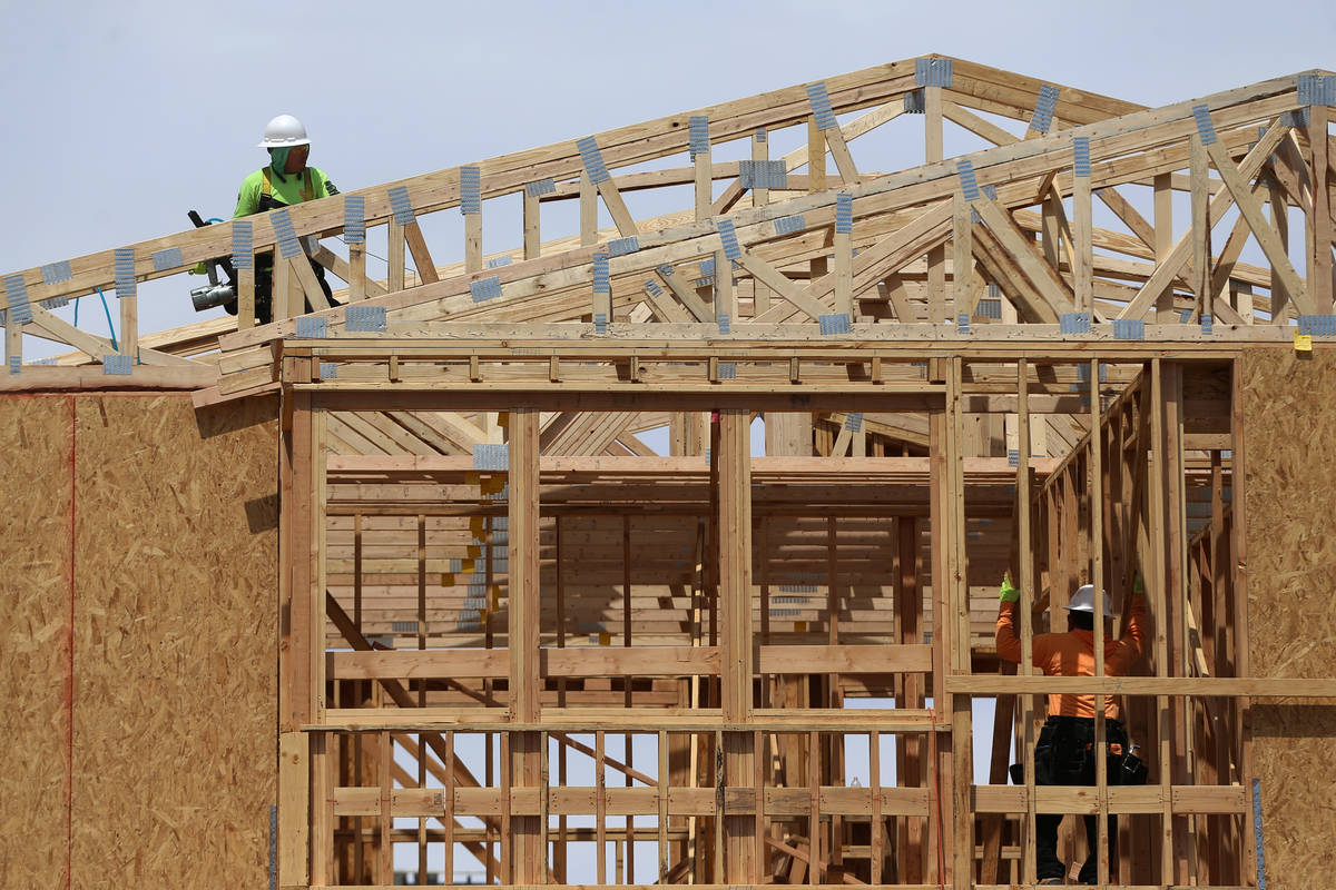 In April, construction workers are shown building a home in Skye Canyon, a master-planned commu ...