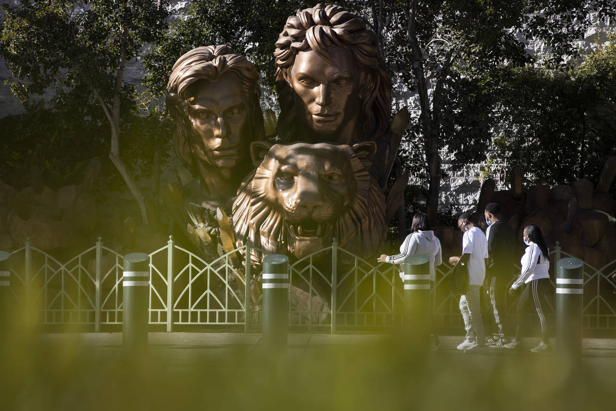 People walk in front of the Siegfried & Roy statue on the Strip in front of The Mirage hote ...