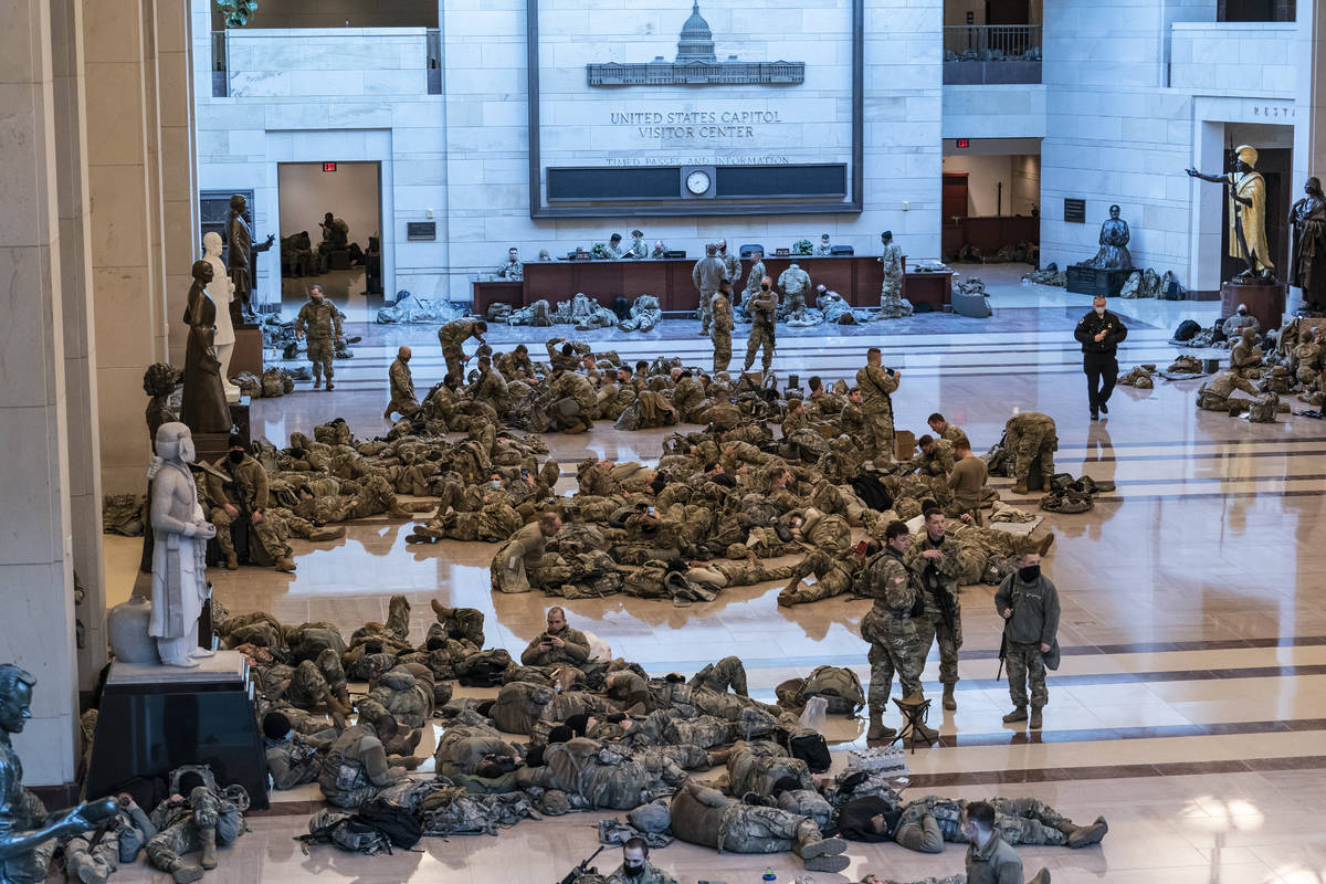 Hundreds of National Guard troops hold inside the Capitol Visitor's Center to reinforce securit ...