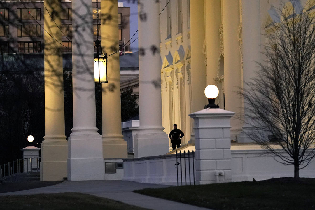 A U.S. Secret Service guard stands post at the North Portico of the White House, after the U.S. ...