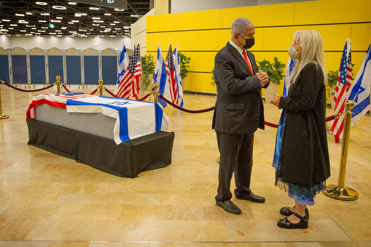 Israeli Prime Minister Benjamin Netanyahu, left, offers his condolences to Dr. Miriam Adelson o ...