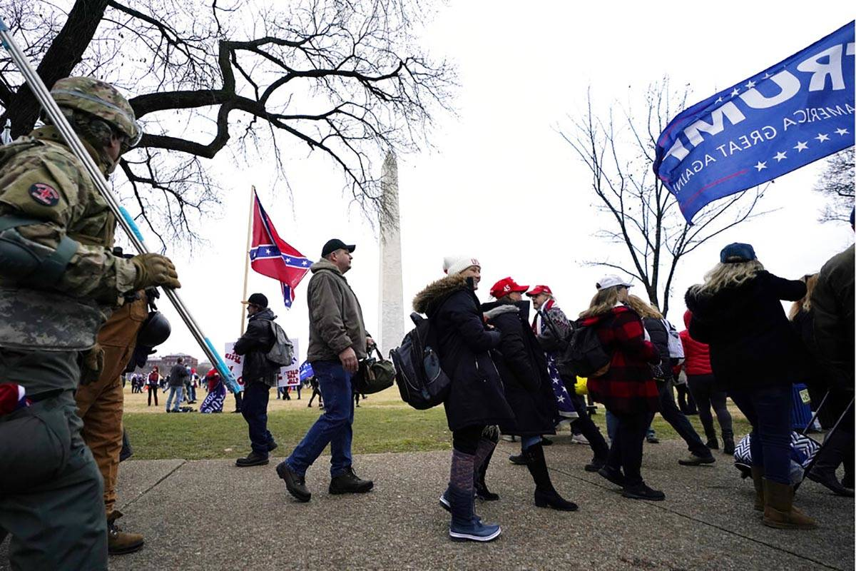 In this Jan. 6, 2021, file photo, Trump supporters gather on the Washington Monument grounds in ...