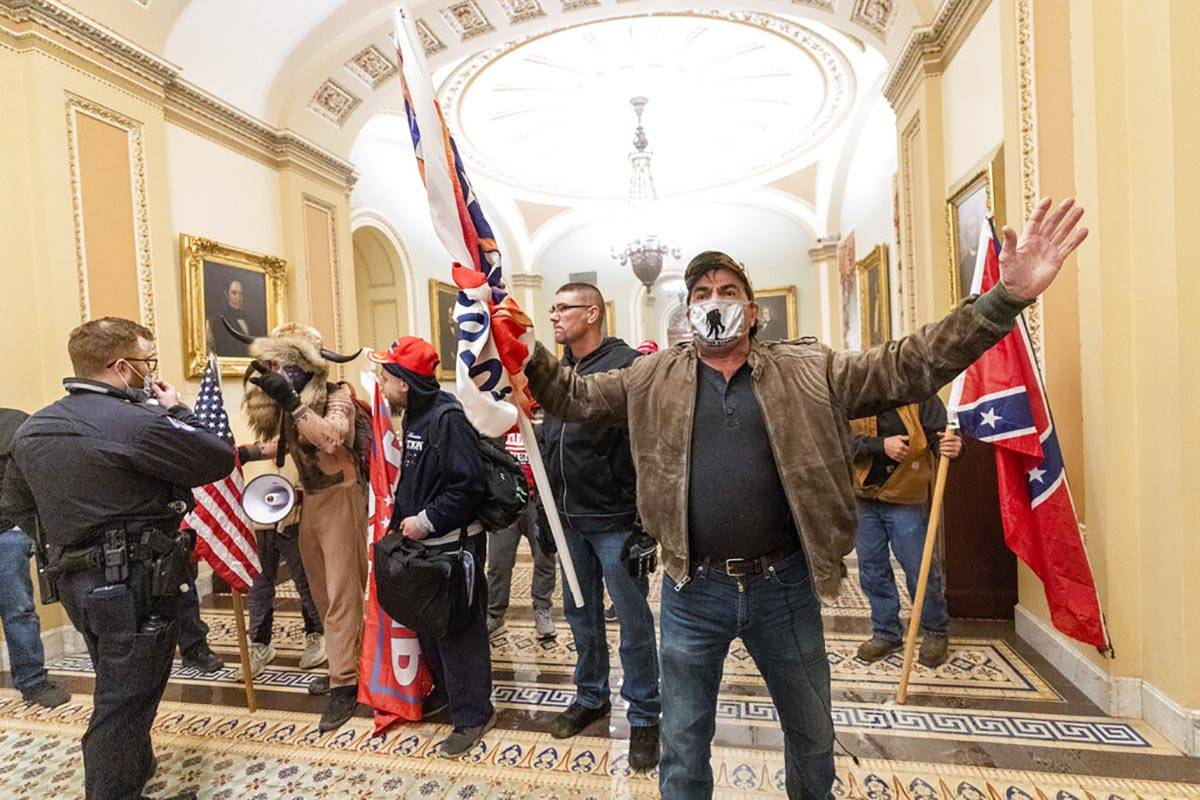 In this Jan. 6, 2021, file photo, supporters of President Donald Trump are confronted by U.S. C ...