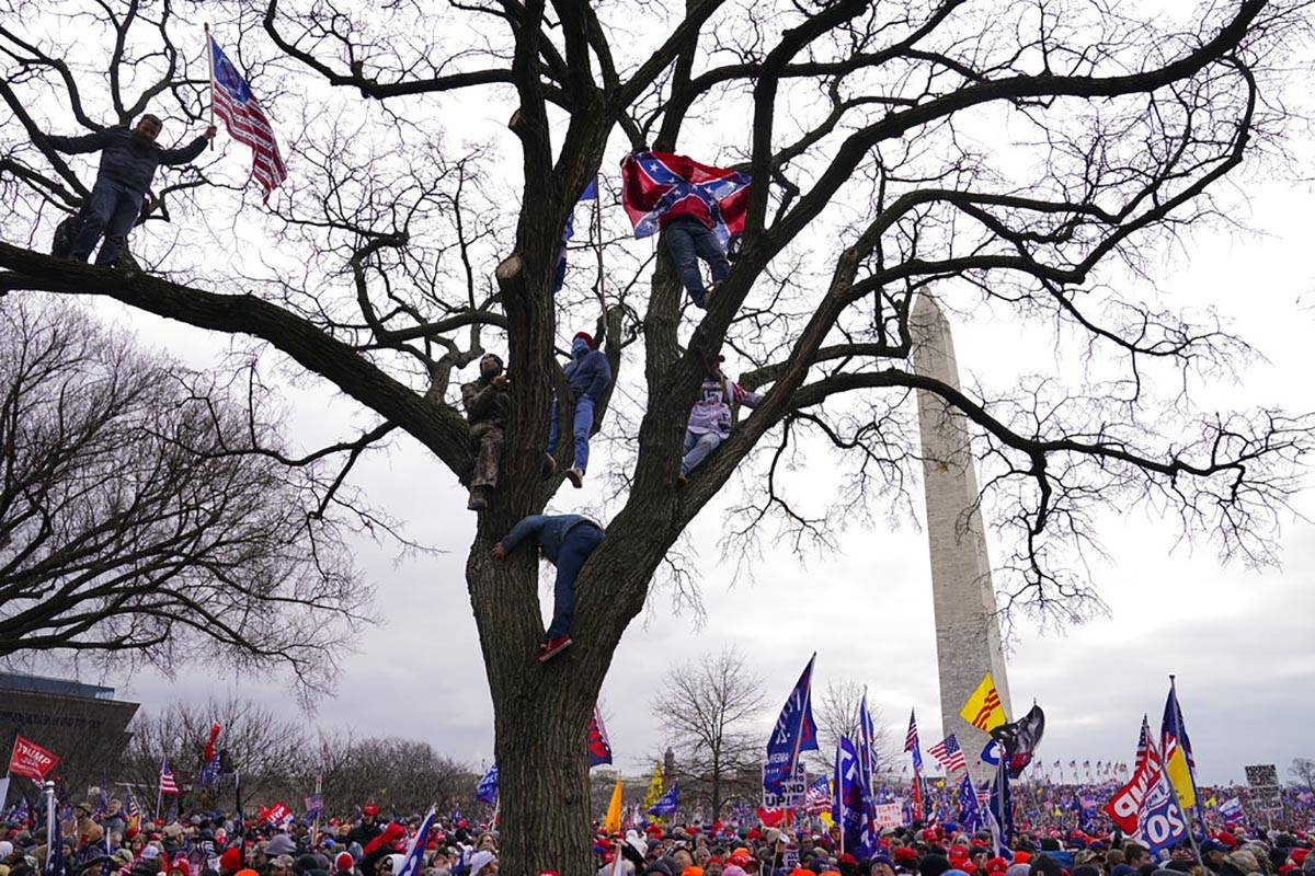 In this Wednesday, Jan. 6, 2021, file photo, supporters of President Donald Trump participate i ...