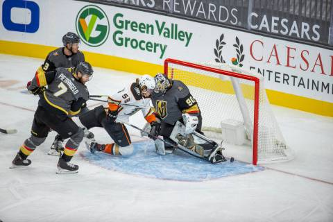 Anaheim Ducks forward Max Comtois (53) collides into Golden Knights goaltender Robin Lehner (90 ...