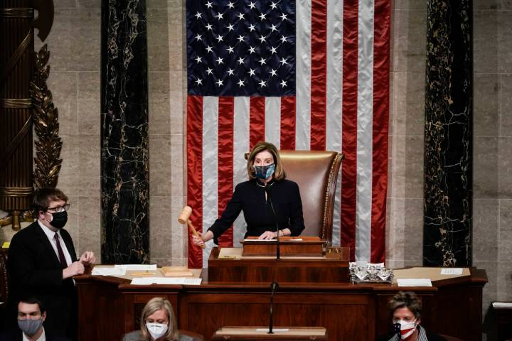 Speaker of the House Nancy Pelosi, D-Calif., gavels in the final vote of the impeachment of Pre ...