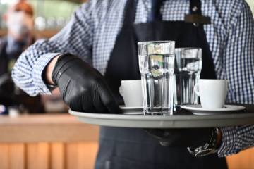 The risk is greater for contracting COVID-19 at restaurants and bars compared to retail establi ...