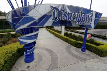 The Disneyland resort is seen in March 2020 due to the coronavirus closure in Anaheim, Calif. ...