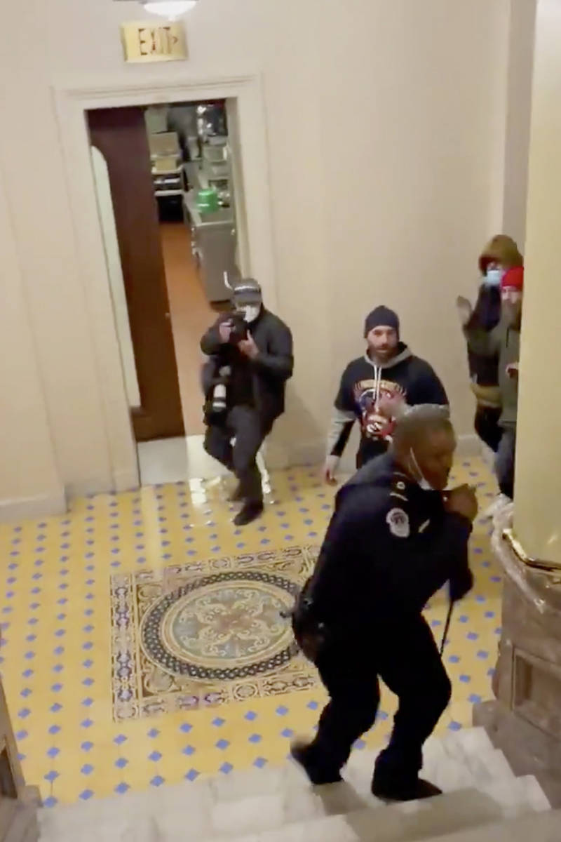 In this image made from video and provided by HuffPost, Capitol Police Officer Eugene Goodman c ...