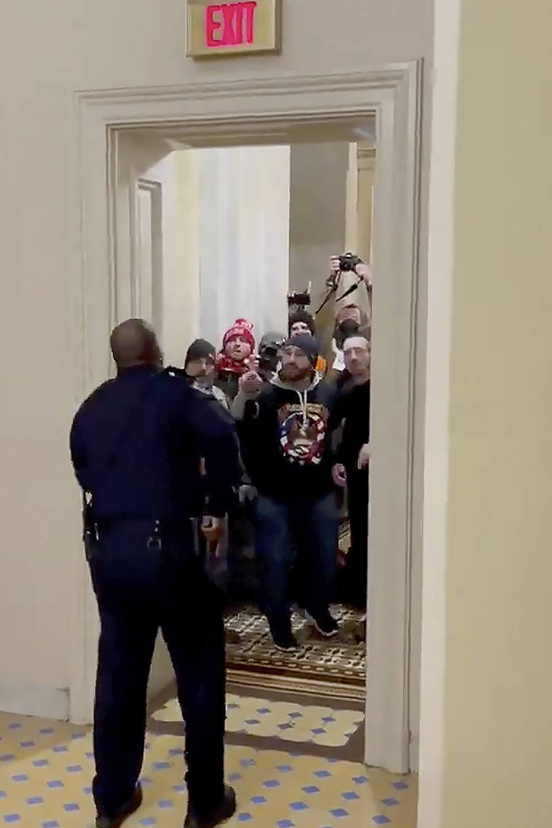 In this image made from video and provided by HuffPost, Capitol Police Officer Eugene Goodman s ...